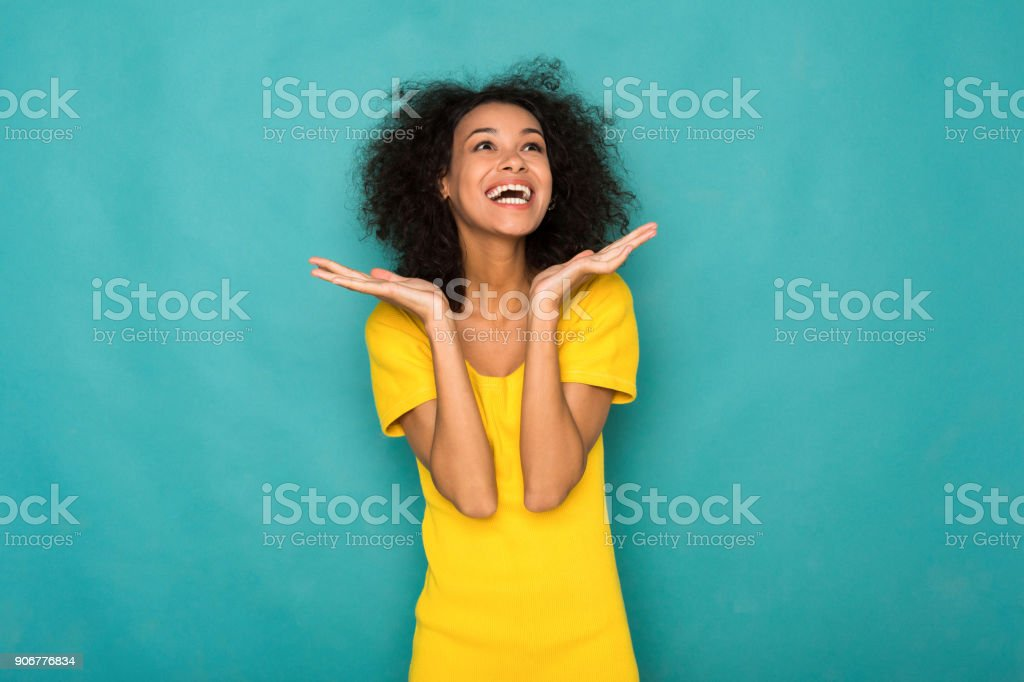 Young smiling african-american woman with arms out stock photo