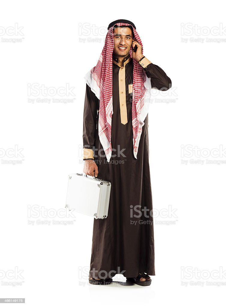 Young smiling arab with a aluminum case and cellphone stock photo