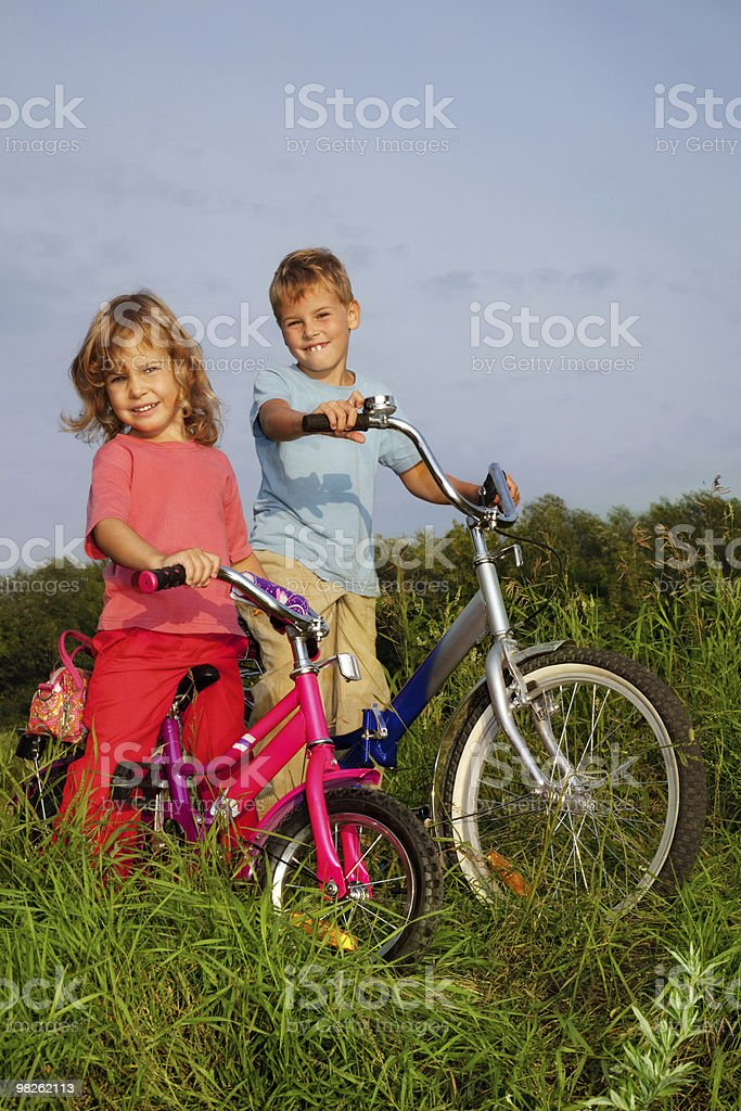 Young smiling bikers rest outdoors royalty-free stock photo