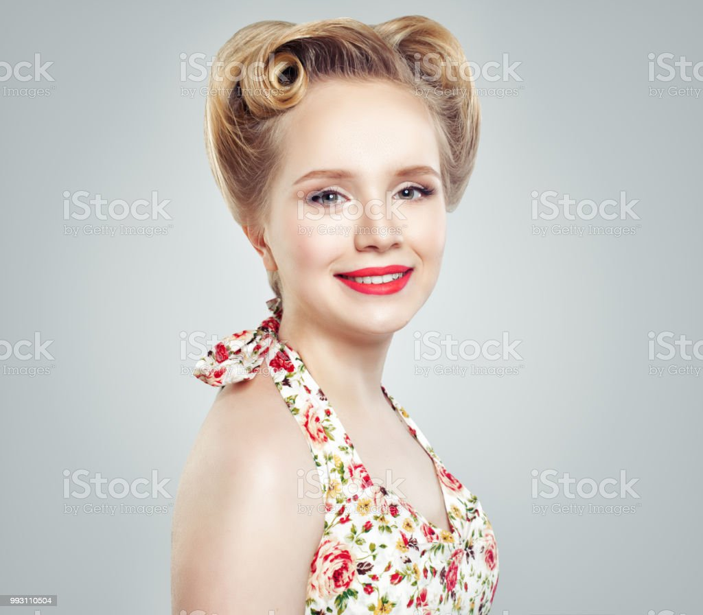 6e27ac693 Young Smiling Blonde Woman On Gray Background Fashion Portrait ...
