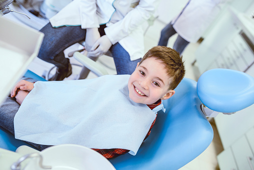 istock Young Smiling Boy Posing Before Regular Dental Check Up in Clinic 1124990856