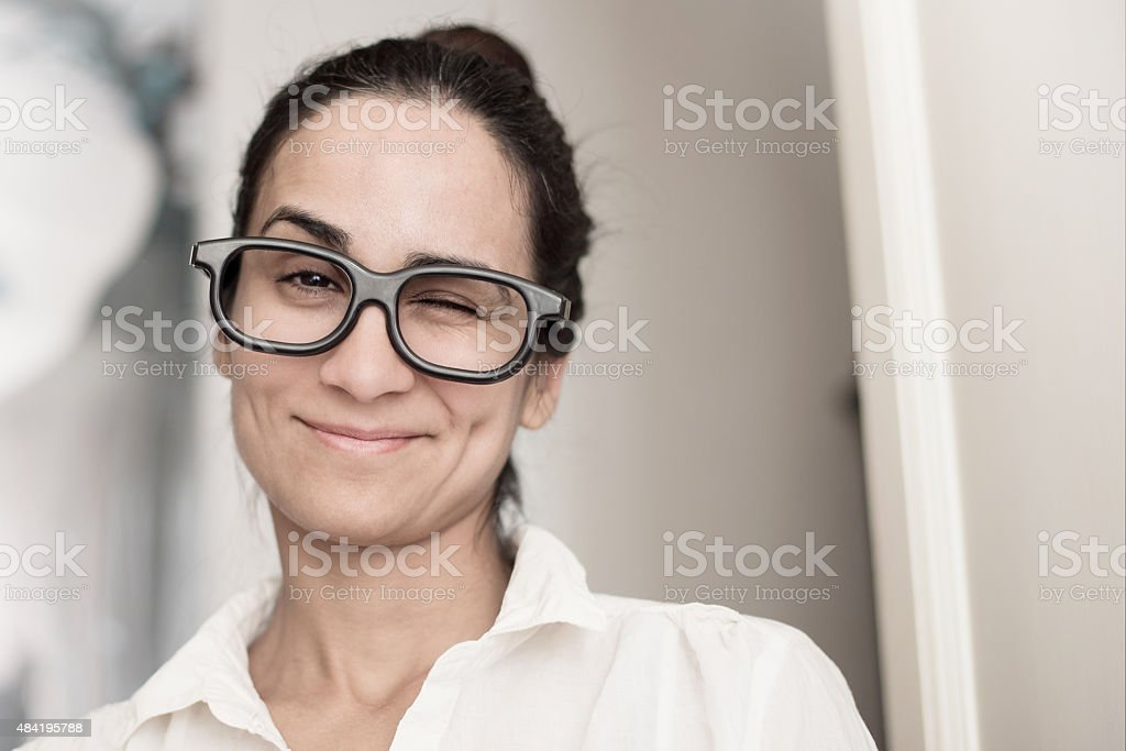 young smiling brazilian business woman twinkling stock photo