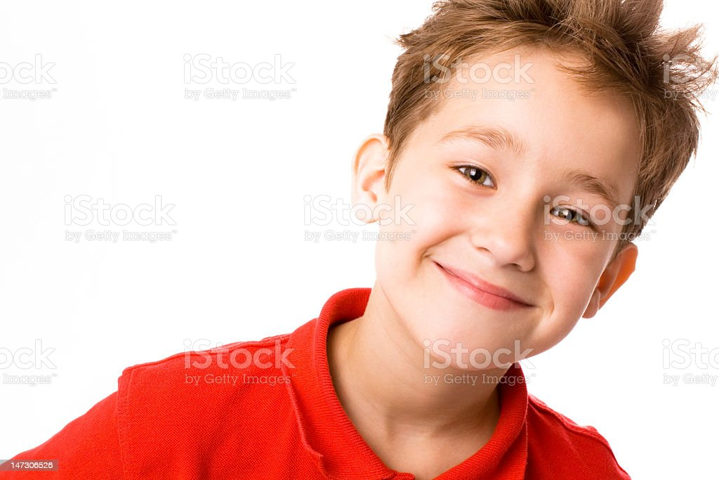 A young, smiling caucasian boy stock photo