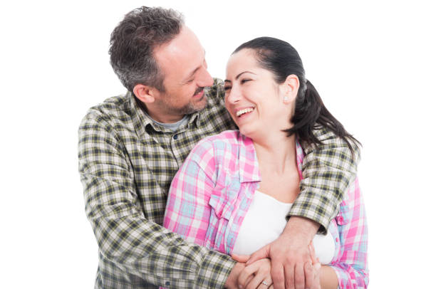 Young smiling couple embracing each other stock photo