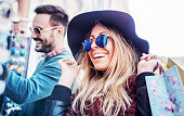 istock Young smiling couple  shopping together 625651384