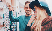 istock Young smiling couple shopping together 637754422