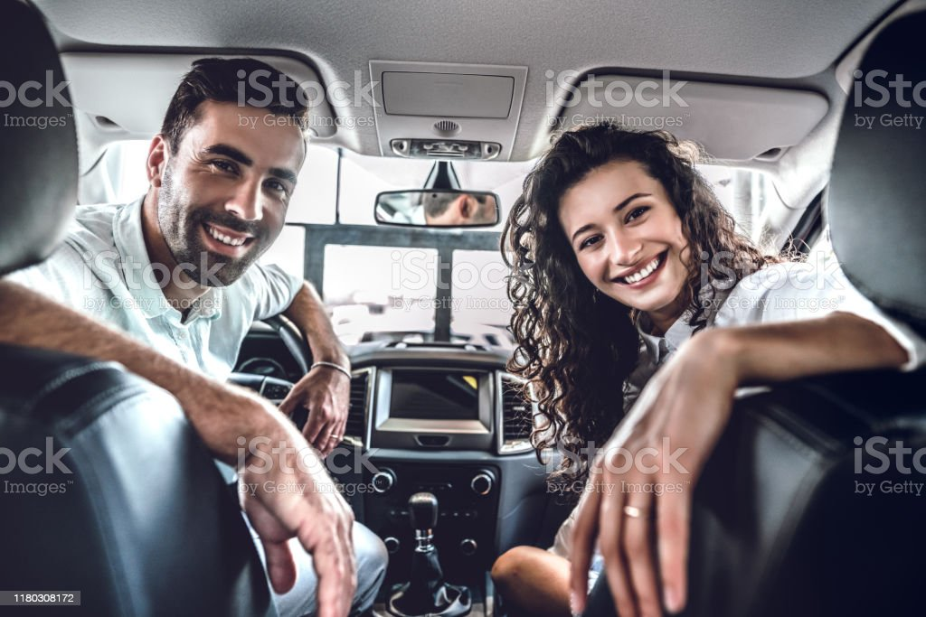 Young Smiling Couple Sitting In The New Car Stock Photo Download Image Now Istock