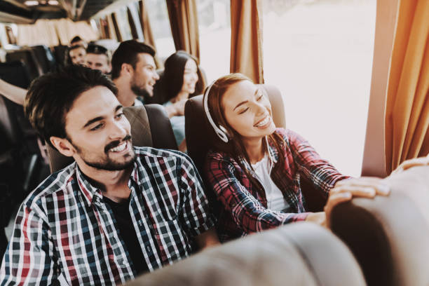 Young Smiling Couple Traveling on Tourist Bus stock photo