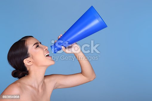 istock Young smiling fashion make up  female holding plastic Megaphone 692854958