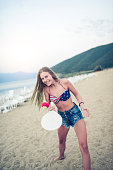 istock Young Smiling Female Playing Beach Tennis Paddle Ball 825378750