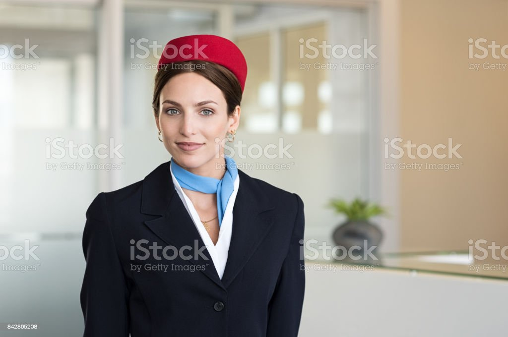 Young smiling flight assistant stock photo