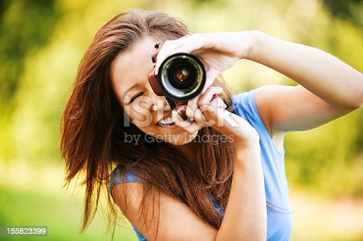 istock young smiling girl making photo 155823399