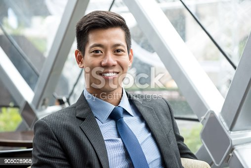 istock Young smiling handsome Asian Thai-Chinese businessman 905028968