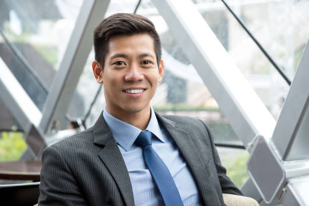 Young smiling handsome Asian Thai-Chinese businessman stock photo