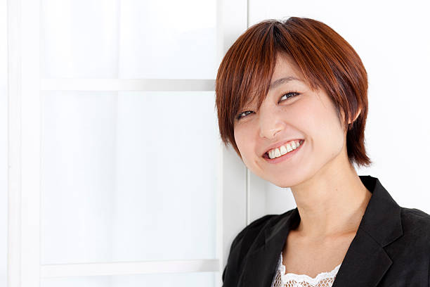 Young smiling Japanese woman (horizontal) stock photo