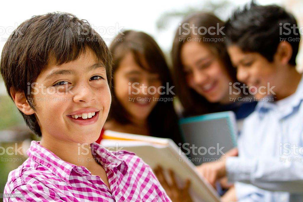 Young smiling male student with a group of others royalty-free stock photo