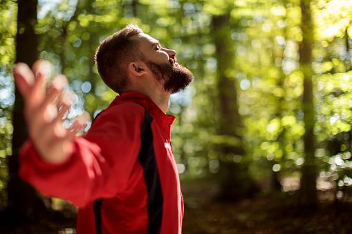 Young smiling man enjoying nature