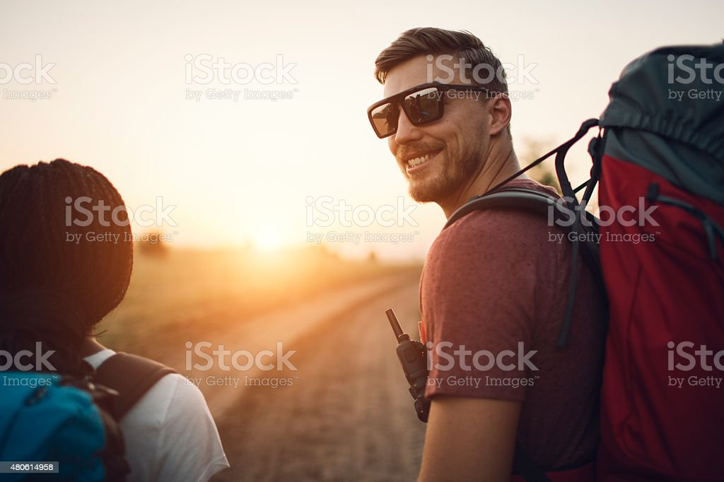 Young Smiling Man Hiking. stock photo
