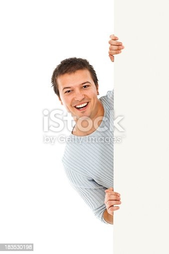 istock Young smiling man holding blank billboard sign 183530198
