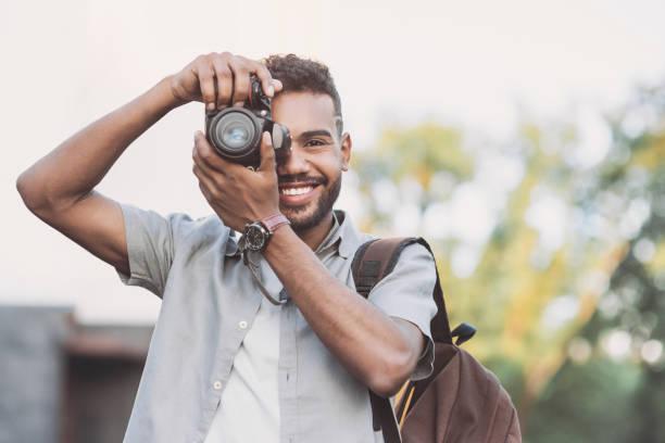 Young smiling man photographer with dslr camera in a city picture id1154794321?b=1&k=6&m=1154794321&s=612x612&w=0&h=  vaac0ryct uq2uchxildhexrjdbse 6qvdwki8w 4=