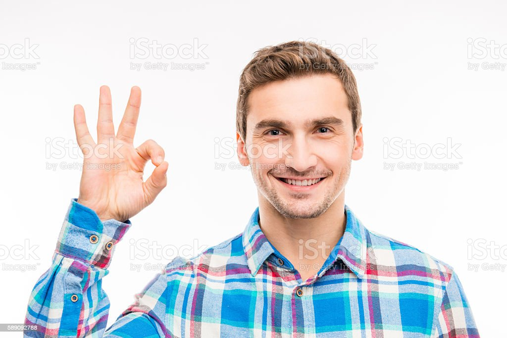 young smiling man shows gesture 'OK' stock photo