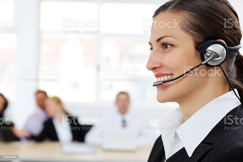 Young smiling operator with headset. royalty-free stock photo