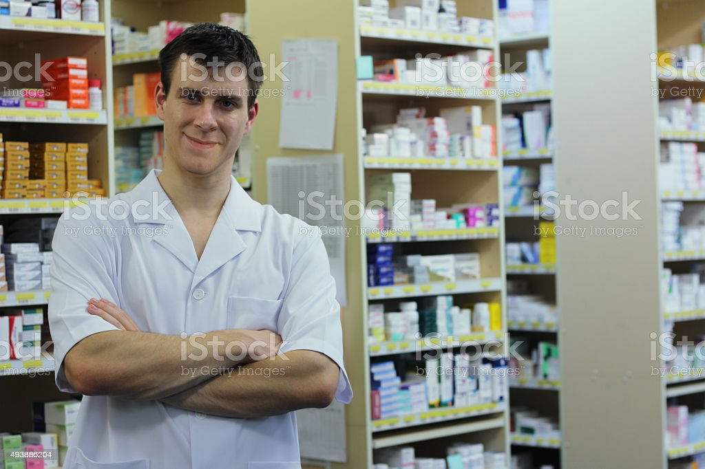Young Smiling Pharmacist In The Dispensary stock photo