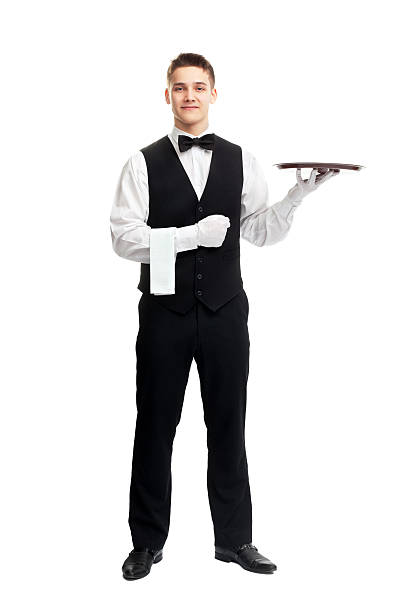 Young smiling waiter with empty tray full length portrait of young happy smiling waiter with empty tray isolated on white background waiter stock pictures, royalty-free photos & images