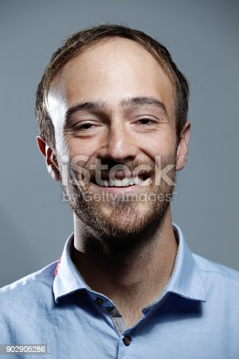612752180istockphoto Young Smiling White man Portrait 902905286