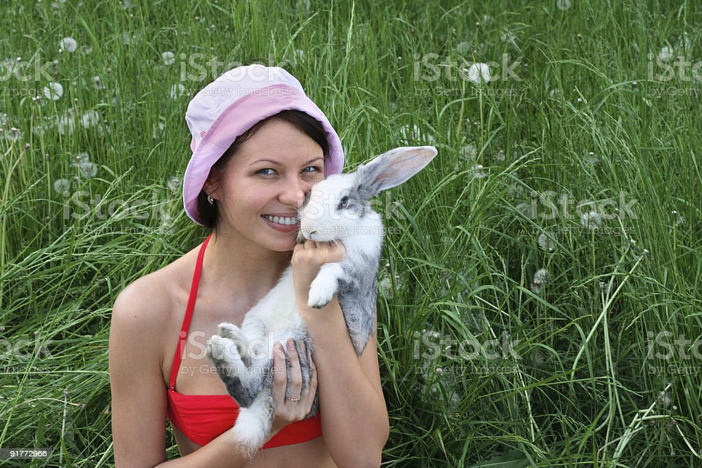 Young smiling woman and rabbit royalty-free stock photo