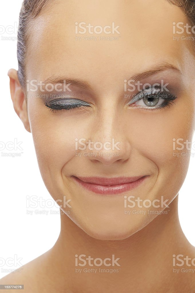 young smiling woman blinking stock photo