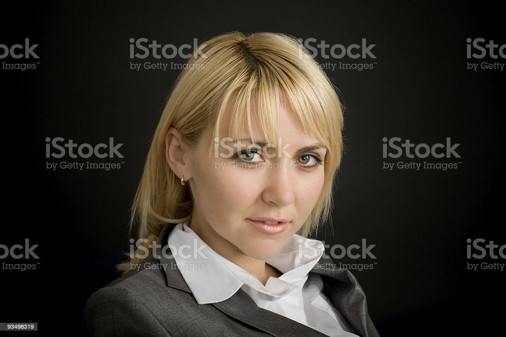 Young smiling woman in a business suit royalty-free stock photo