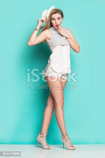istock Young smiling woman in a summer dress 544470956