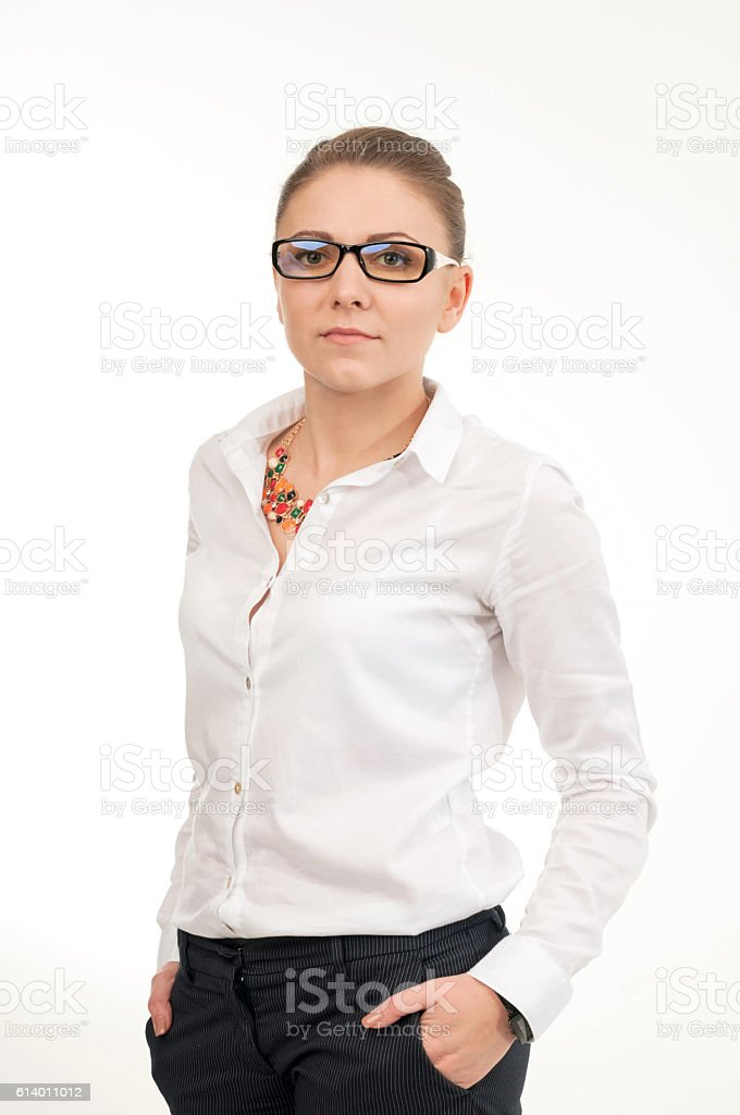 Young smiling woman in a white shirt and glasses stock photo