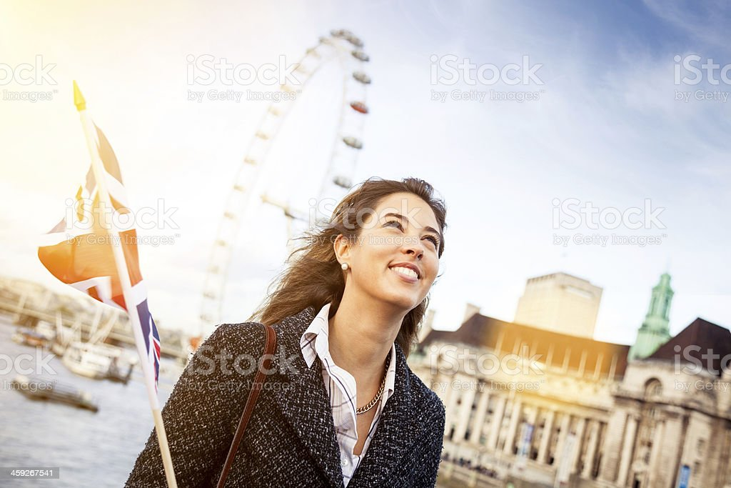 Young smiling woman in visit to London royalty-free stock photo