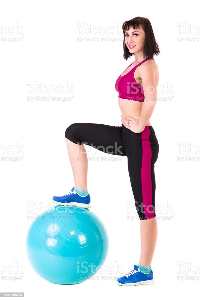 Young smiling woman makes exercise with fitball royalty-free stock photo