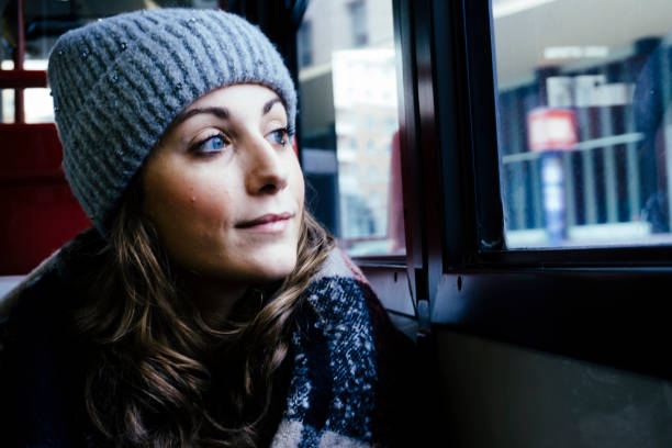 Young smiling woman on a bus stock photo