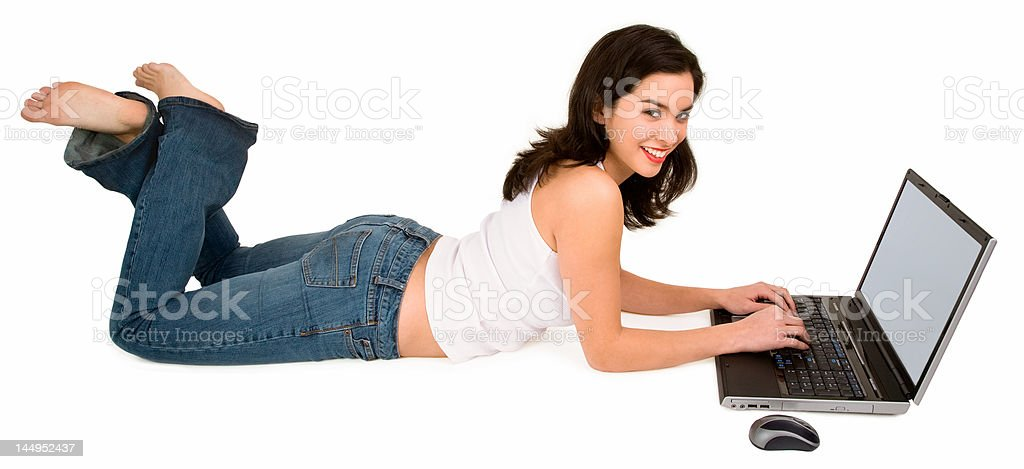 Young Smiling Woman on Floor Using Laptop royalty-free stock photo