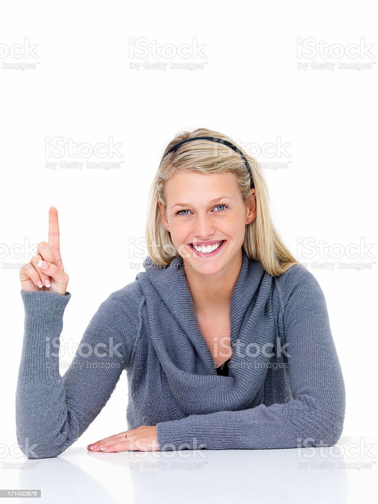 Young smiling woman pointing finger upwards  royalty-free stock photo