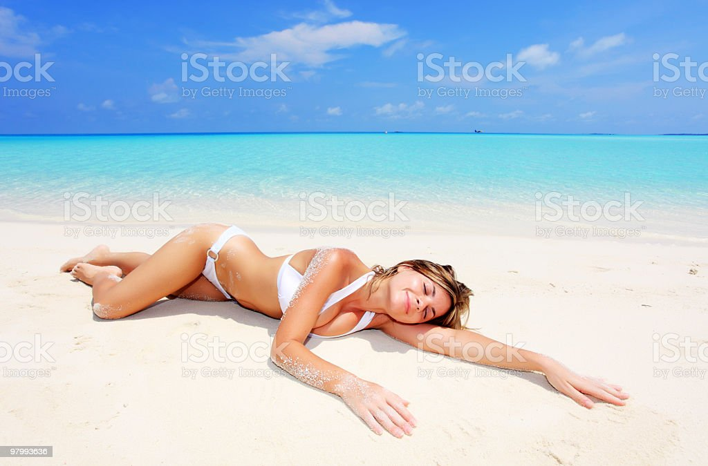 Young smiling woman resting on the beach royalty-free stock photo