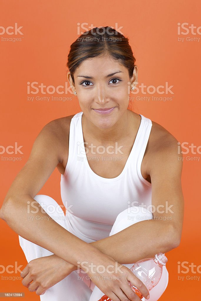 Young smiling woman sitting in comfortable clothing royalty-free stock photo