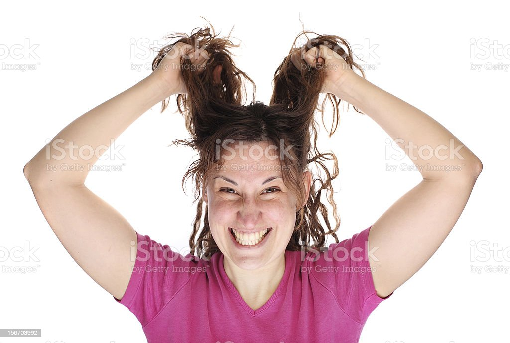Young smiling woman tearing her hair out royalty-free stock photo
