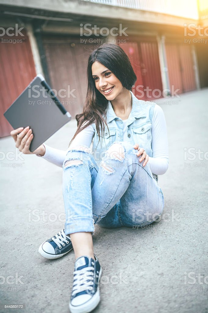 young smiling woman using digital tablet stock photo