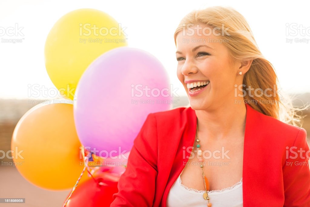 Young smiling woman with balloons royalty-free stock photo