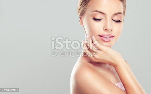 istock Young, smiling woman with clean, fresh, skin. 625435512