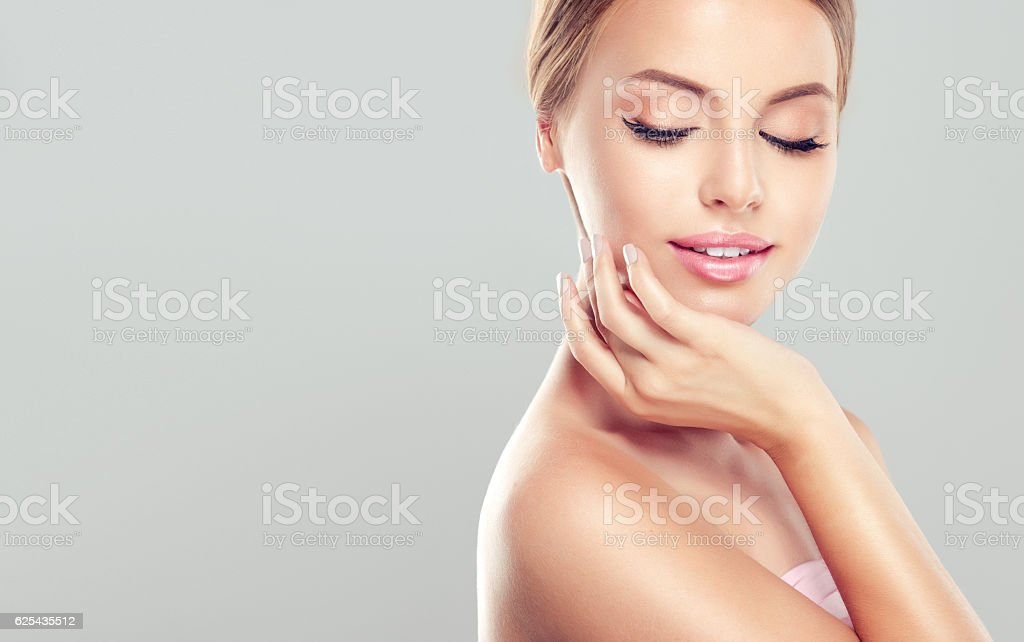 Young, smiling woman with clean, fresh, skin. stock photo
