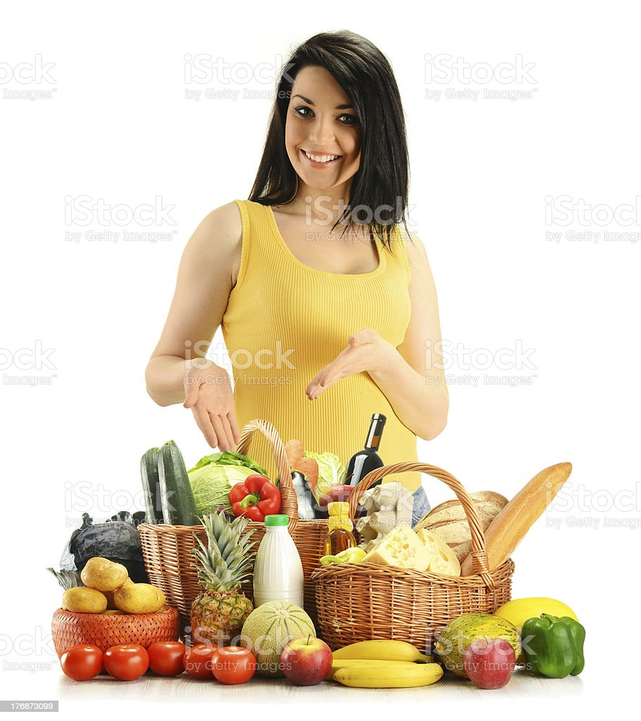 Young smiling woman with groceries royalty-free stock photo