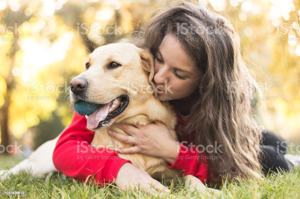 Young smiling woman with her cute dog stock photo