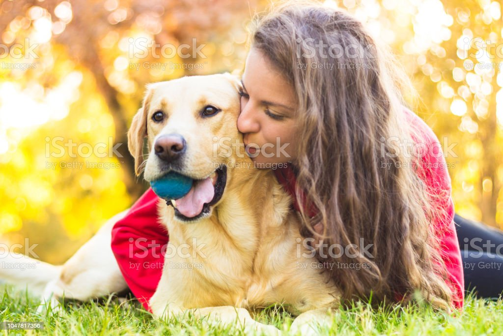 Young smiling woman with her dog stock photo