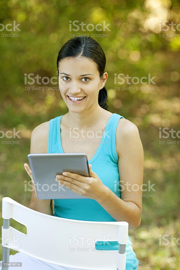 young smiling woman working on tablet royalty-free stock photo